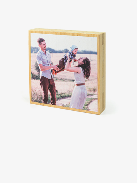 Collage of family memories on wood photo block.