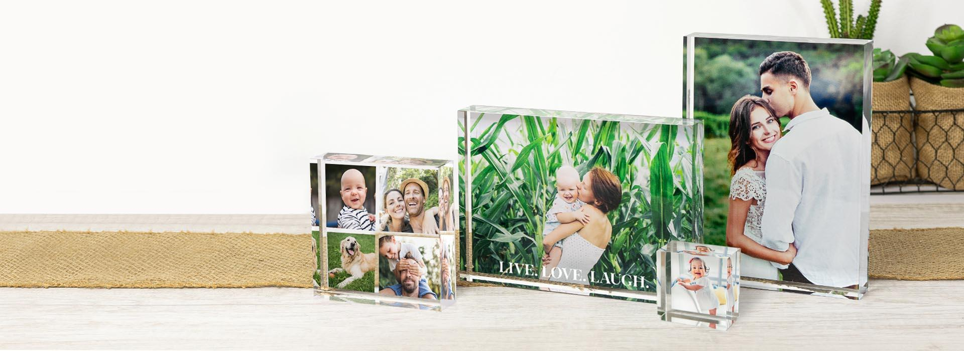 Family photo memories on holiday gifts under a Christmas tree.