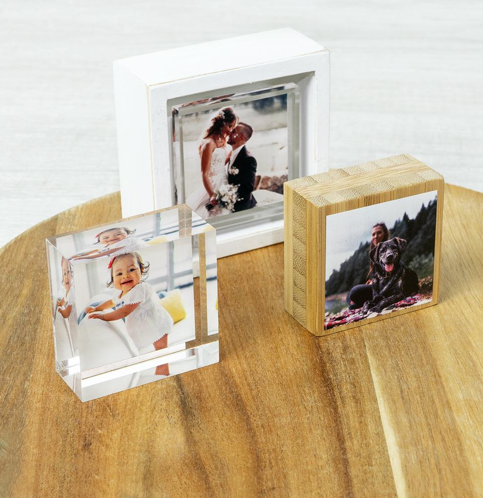 Acrylic block featuring father and son sitting on wooden table in front of lit Christmas tree.