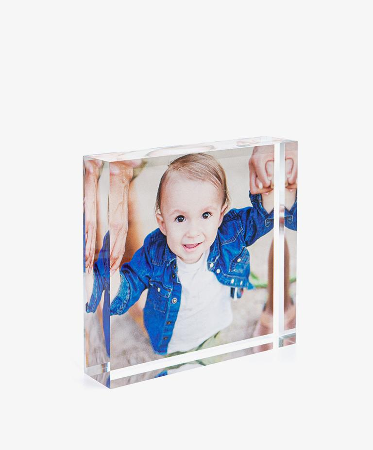 Family wearing winter clothing on three dimensional acrylic photo block.